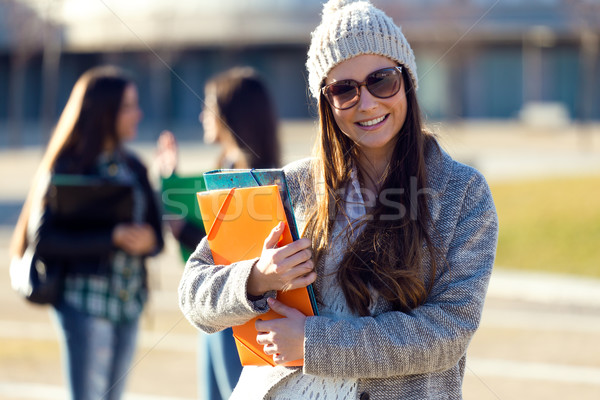 Student girl looking at camera in the campus of university. Stock photo © nenetus