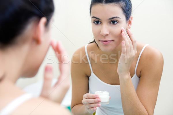 Test törődés nő jelentkezik krém arc Stock fotó © nenetus