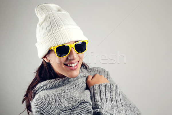 Pretty young woman with white wool cap and yellow sunglasses Stock photo © nenetus
