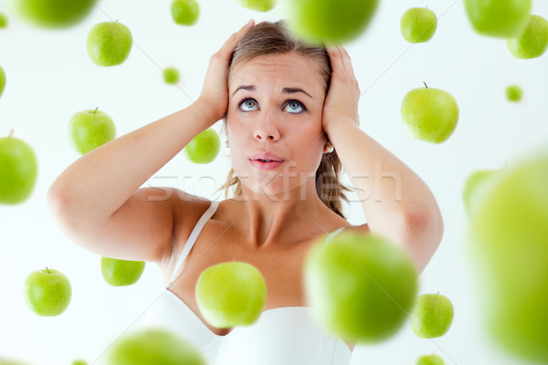 Young girl overwhelmed by diet, surrounded by apples. Stock photo © nenetus