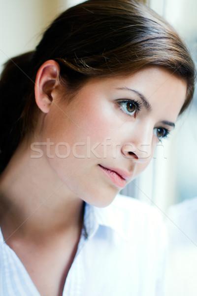 Fiatal nő gondolkodik néz ki ablak portré Stock fotó © nenetus