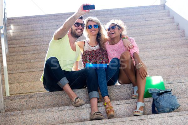 Three university students taking a selfie in the street. Stock photo © nenetus