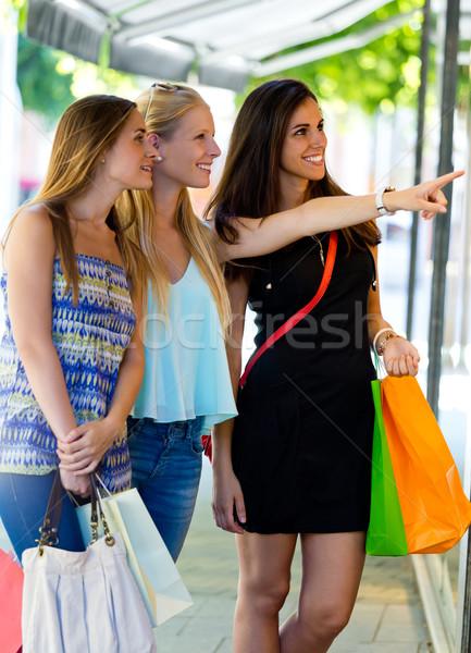 Group of beautiful girls looking at the shop window.  Stock photo © nenetus