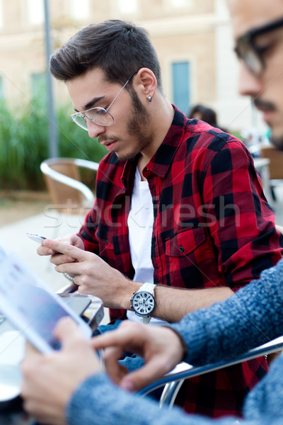 Two young entrepreneurs working at coffee shop.  Stock photo © nenetus