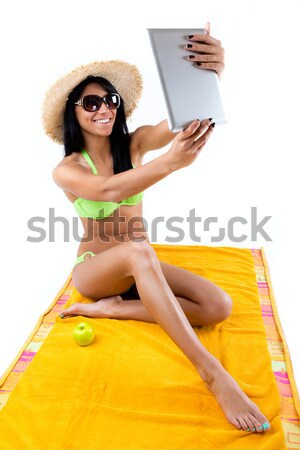 Happy young girl with green bikini talking on mobil phone Stock photo © nenetus