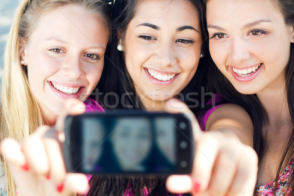 three friends taking photos with a smartphone Stock photo © nenetus