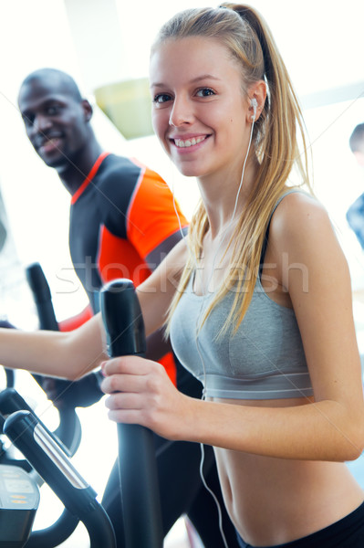 Young people with elliptic machine in the gym. Stock photo © nenetus