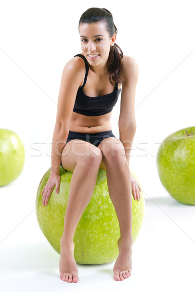 slender woman in fitness clothes sitting atop a giant apple Stock photo © nenetus