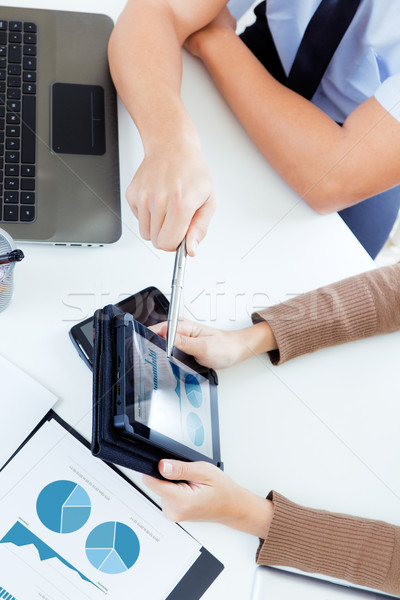 executive hands with digital tablet in a financial meeting Stock photo © nenetus