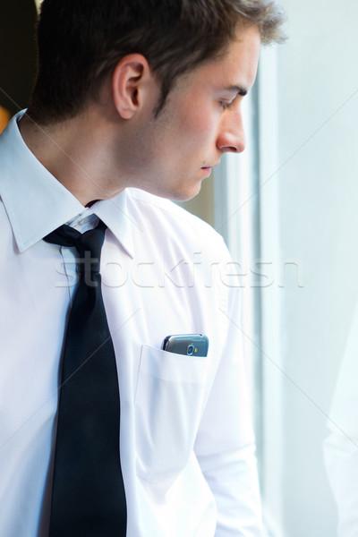 Jovem empresário telefone móvel escritório retrato negócio Foto stock © nenetus