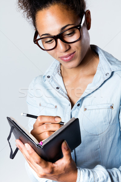 Fiatal afroamerikai nő jegyzetel otthon csinos iroda Stock fotó © nenetus