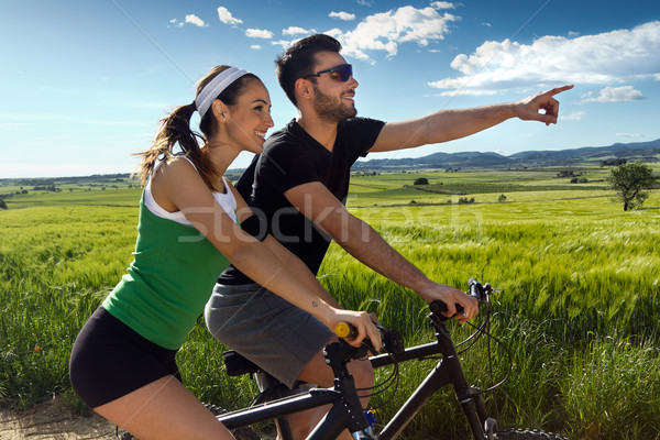 Happy young  couple on a bike ride in the countryside Stock photo © nenetus