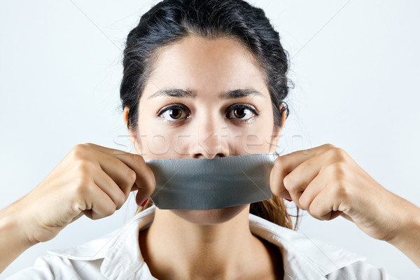 Woman with mouth covered with tape. Concept of forbidden opinion Stock photo © nenetus