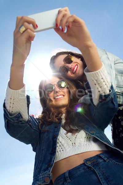 Kızlar fotoğrafları iki güneş gözlüğü Stok fotoğraf © nenetus
