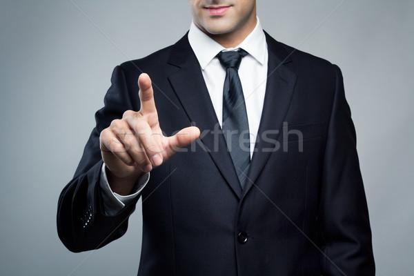Young executive man touching an imaginary screen Stock photo © nenetus