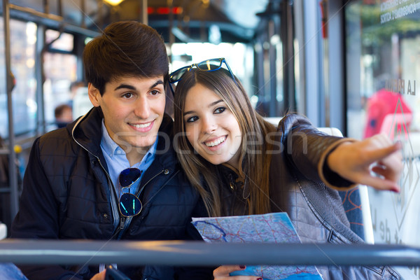 Young couple use their map and pointing where they want to go. Stock photo © nenetus