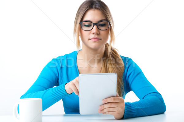 Young smiling woman using digital tablet. Isolated on white. Stock photo © nenetus