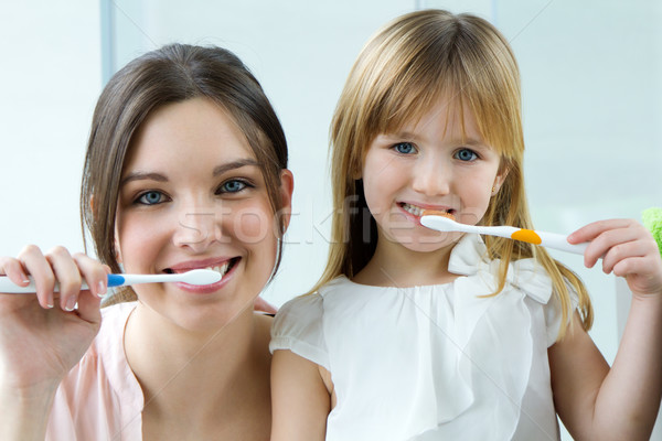 Mother and daughter brushing teeth in the bathroom Stock photo © nenetus