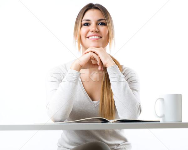 Genç güzel kız okuma haber içme kahve Stok fotoğraf © nenetus