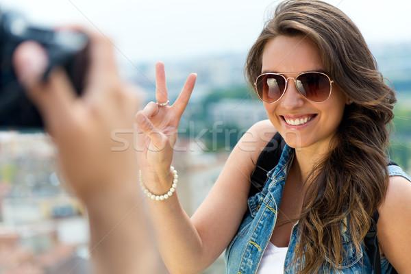 Young men taking photo of his girlfriend. Stock photo © nenetus