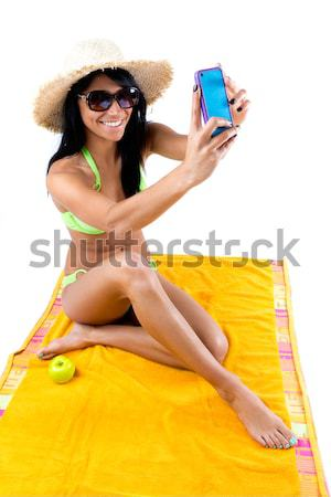 Happy young girl with green bikini and digital table Stock photo © nenetus