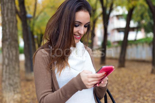 Beautiful girl telefone móvel outono ao ar livre retrato Foto stock © nenetus