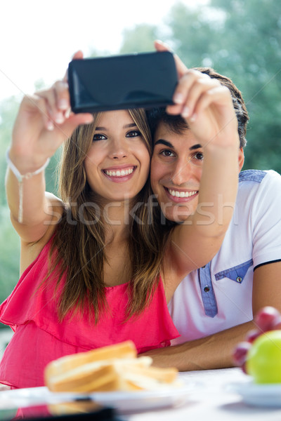 Couple taking photo of themselves with smart phone on romantic p Stock photo © nenetus