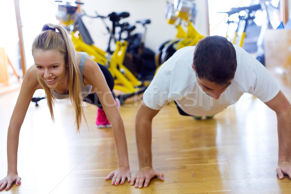 Young people doing exercise on the floor in the gym. Stock photo © nenetus