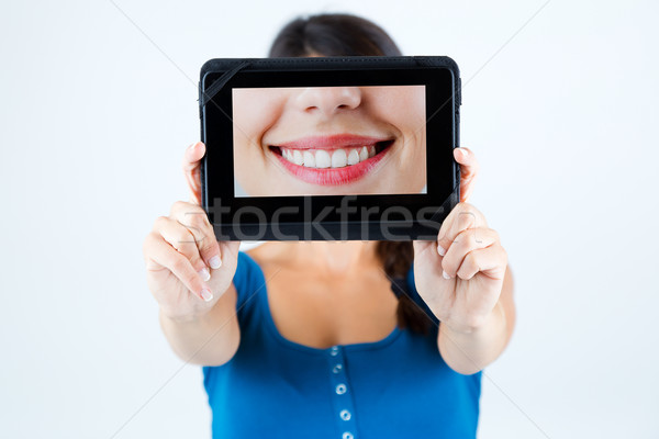 Beautiful girl holding a picture of a mouth smiling. Stock photo © nenetus