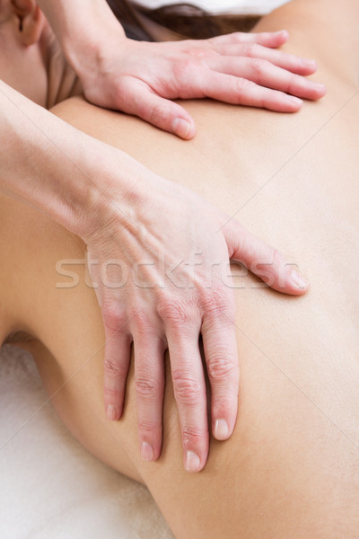 Woman enjoying shoulder massage at beauty spa Stock photo © nenetus