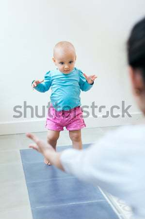 Baby girl learning to walk at home Stock photo © nenetus