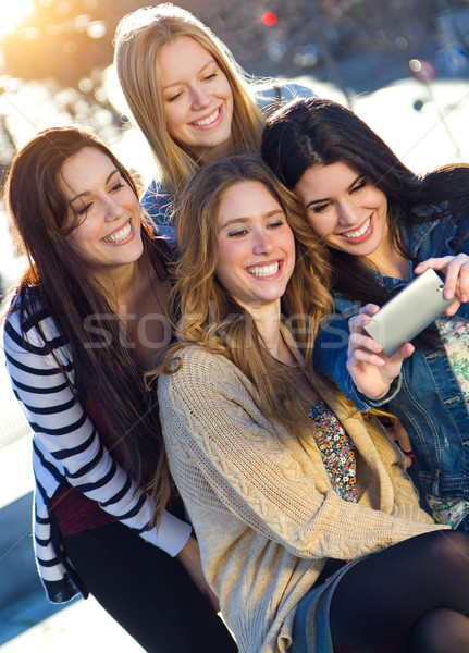 A group of friends taking photos with a smartphone Stock photo © nenetus