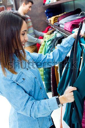 Beautiful couple shopping in a clothes shop. Stock photo © nenetus