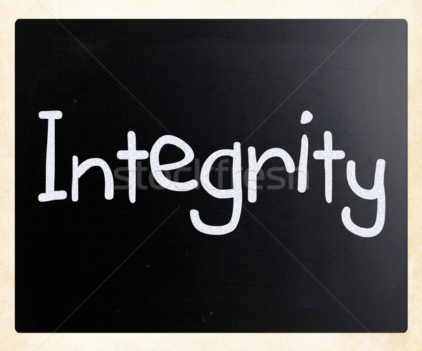 """The word """"Integrity"""" handwritten with white chalk on a ..."""