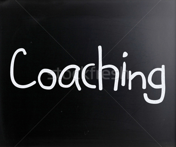 'Coaching' handwritten with white chalk on a blackboard Stock photo © nenovbrothers