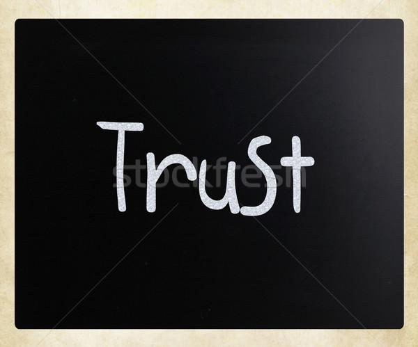 The word 'Trust' handwritten with white chalk on a blackboard Stock photo © nenovbrothers