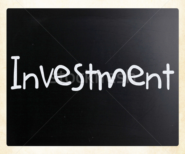 Stock photo: The word 'Investment' handwritten with white chalk on a blackboa
