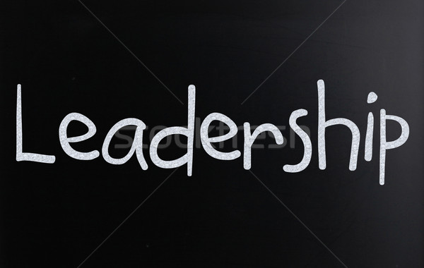 The word 'Leadership' handwritten with white chalk on a blackboa Stock photo © nenovbrothers