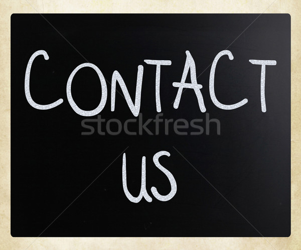 Kapcsolatfelvétel kézzel írott fehér kréta iskolatábla üzlet Stock fotó © nenovbrothers