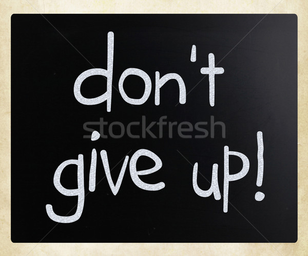'Don't give up' handwritten with white chalk on a blackboard Stock photo © nenovbrothers