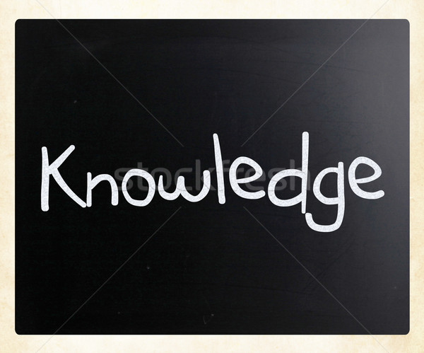 'Knowledge' handwritten with white chalk on a blackboard Stock photo © nenovbrothers