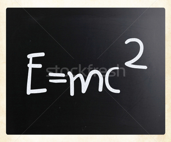 E=mc2 handwritten with white chalk on a blackboard Stock photo © nenovbrothers