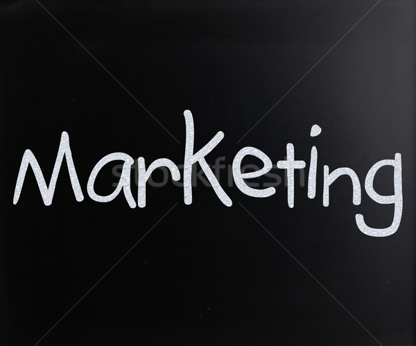 The word 'Marketing' handwritten with white chalk on a blackboar Stock photo © nenovbrothers