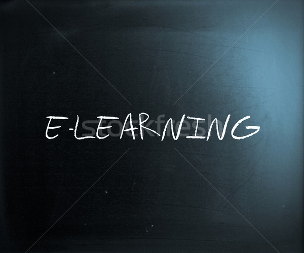 'E-learning' handwritten with white chalk on a blackboard Stock photo © nenovbrothers
