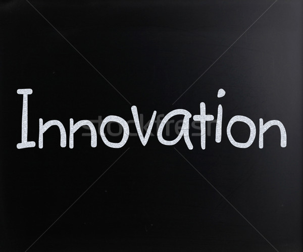 The word 'Innovation' handwritten with white chalk on a blackboa Stock photo © nenovbrothers