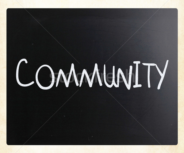 'Community' handwritten with white chalk on a blackboard Stock photo © nenovbrothers