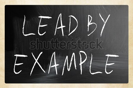 'Lead by example' handwritten with white chalk on a blackboard Stock photo © nenovbrothers