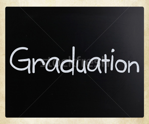 The word 'Graduation' handwritten with white chalk on a blackboa Stock photo © nenovbrothers