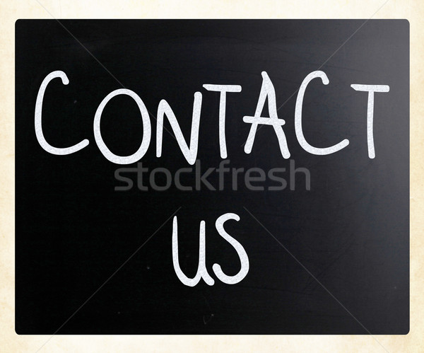 'Contact Us' handwritten with white chalk on a blackboard Stock photo © nenovbrothers