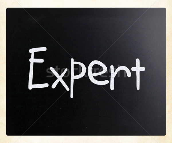 The word 'Expert' handwritten with white chalk on a blackboard Stock photo © nenovbrothers